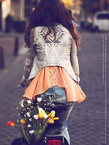 vegan leather jacket with orange top from free people girls on bike january catalog